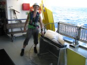 Julia Reisser stands next to the manta net onboard RV Southern Surveyor.