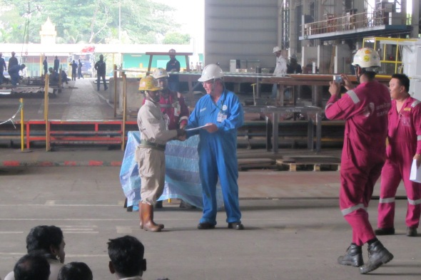 Don McKenzie presenting an HSE Award at the Sembawang Shipyard